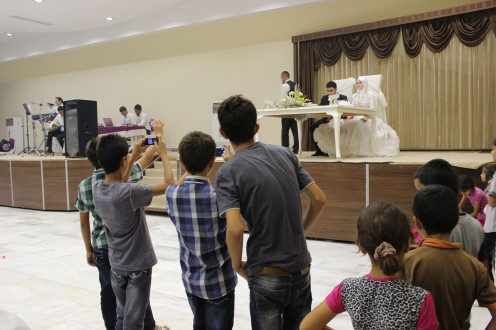 youth-taking-photos-at-a-wedding-in-turkey